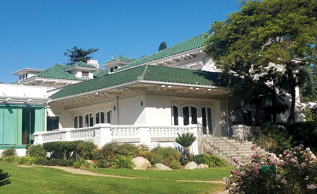 Wrigley Mansion: Tournament of Roses House historical green clay roof tile view from garden in Pasadena, CA