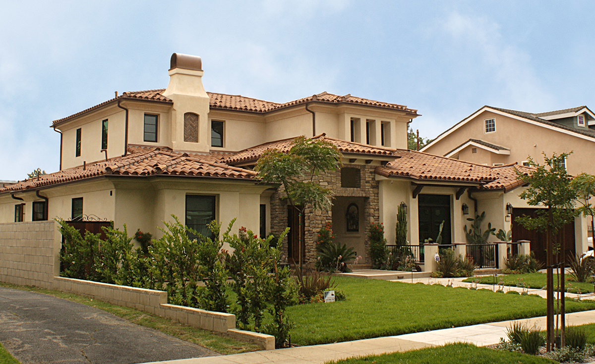Classic S Mission clay roof tile with Two Piece Eave Application in CB4645D-SC Rustic Tuscan Dark on home in Burbank, CA