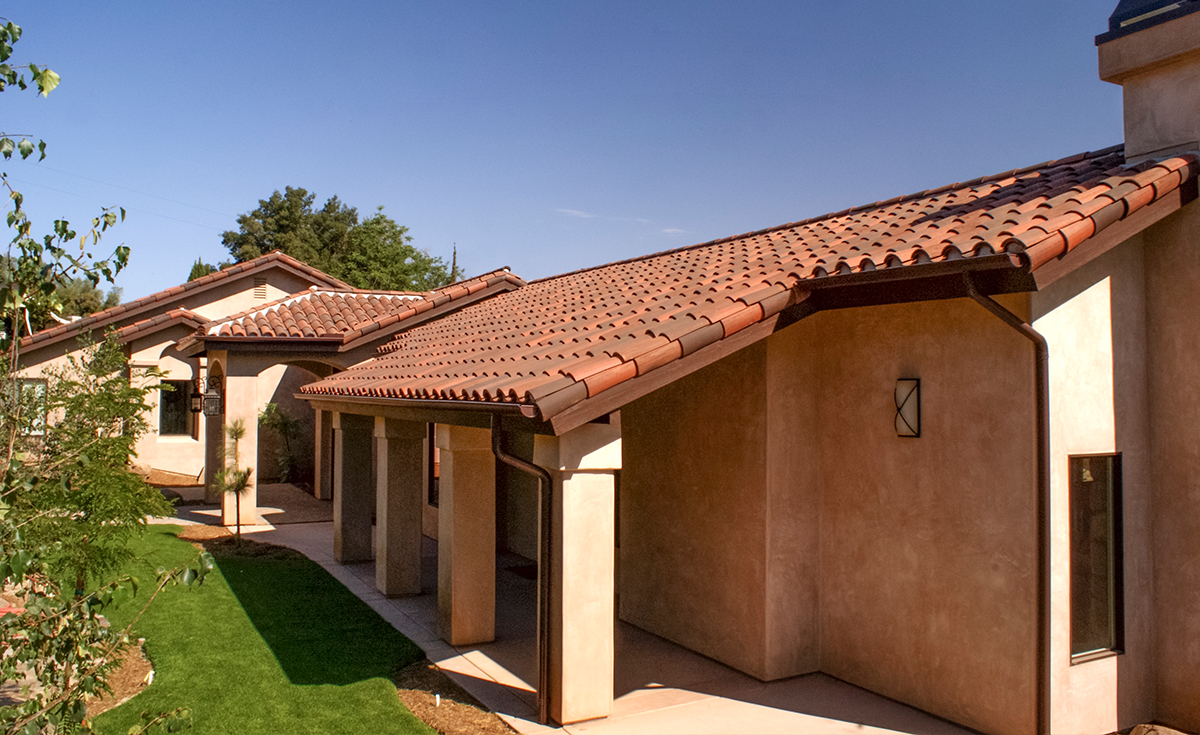 Side view of Classic S mission clay roof tile with 2 piece eave line in 1/3 B330-R Old Santa Barbara Blend, 1/3 2F45-SC Tobacco Sand Cast, and 1/3 2F45CC16D Tierra Brown Dark (Smooth) on custom home in El Cajon, California