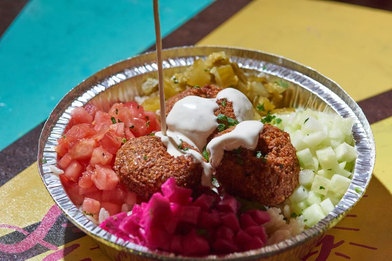 Falafel Bowl, fried chickpea patties topped with tahini and surrounded by vegetables. Zahra Middle Eastern Cuisine at the NEW Allentown Market. Friday December 27, 2019