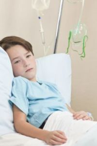 Young Boy Child Patient In Hospital Bed
