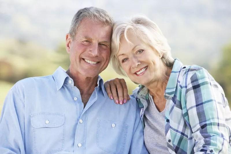 Dental Implant Patients Smiling After Their Dental Procedures
