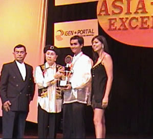 Aldrin D. Gabriel (2nd from right) receives an award given by the Asia-Pacific Excellence organizers.