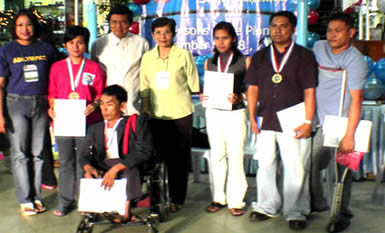 Dianne A. Barcelona is flanked by other competitors and TESDA Directors and NCWDP Head. The awarding ceremony was held at Robinson's Place, EDSA. Eight PWD's from different regions competed in the English Text Processing event.