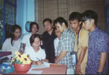 Ma'am Maileen Antonio, Principal of Isabela School for the Deaf in Ilagan, Isabela signs the contract of agreement while the whole team looks on.