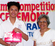 Jerome Tanimura is all smiles after receiving the 1st prize.