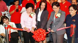 Event organizers on a ribbon cutting ceremony