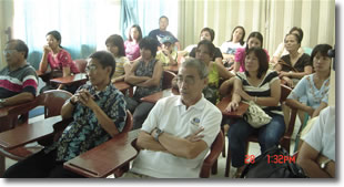 Parents listen intently to orientation.