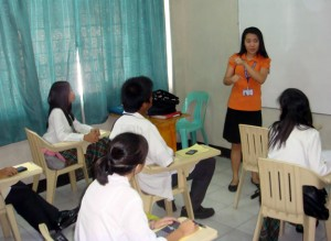 Ma'am Charmagne briefs the students in Business Math contest.