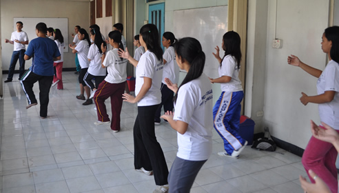 Students copy the basic moves.