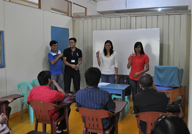 Monde Nissin HRD Staff Nilda Villa and Lara Bombasey introduces themselves to deaf applicants.