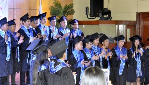 Graduating class renders their special number in sign language.