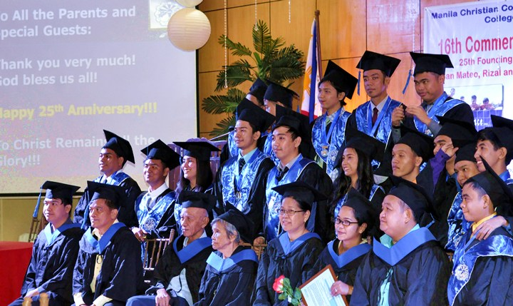Graduating class pose together with administration and faculty