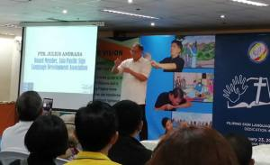 Deaf Pastor Julius Andrada introduces FSL Bible Translation Project to the guests.