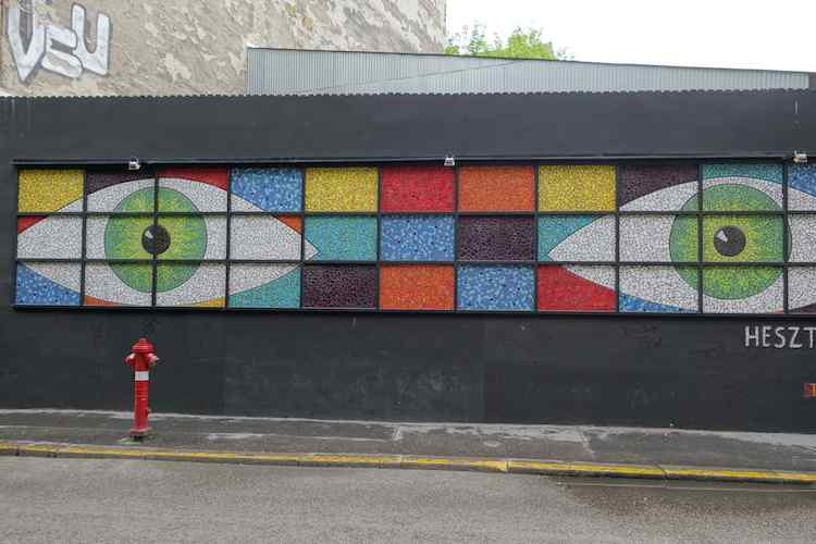 colorful music street art of eyes in Budapest by Heszt