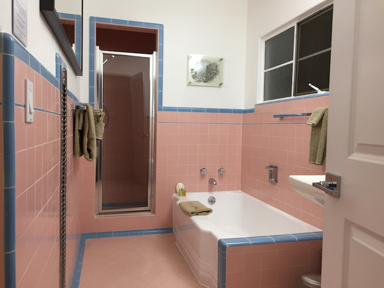 classic pink tile bathroom in mid century modern Palm Springs house