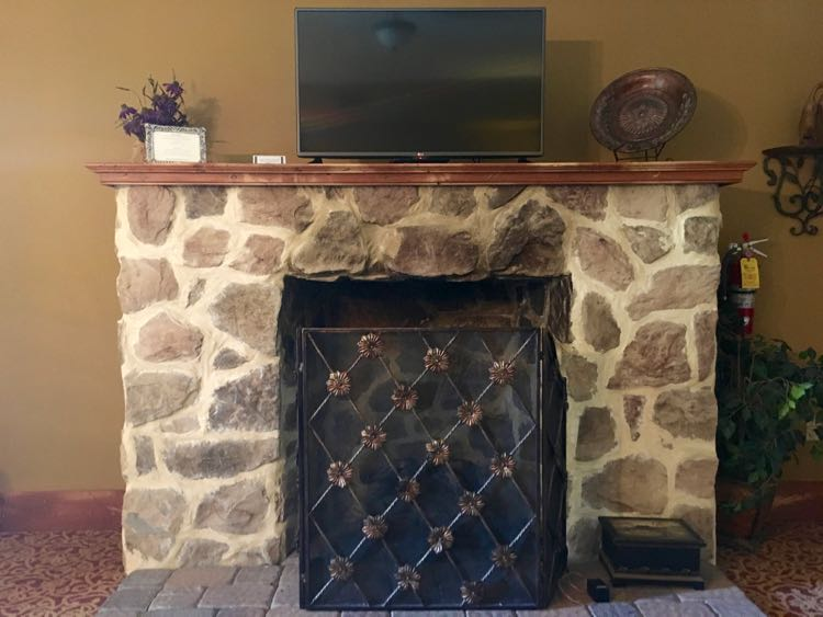 stone fireplace in Inn at Leola Village room