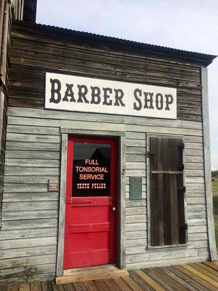 old timey barber shop at Spindletop Gladys City Boomtown Museum