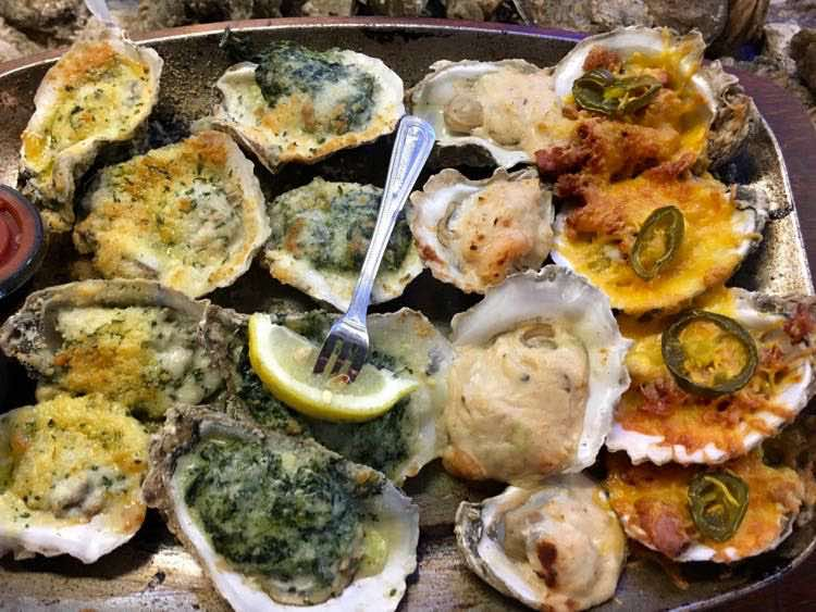 four types of grilled oysters at Wintzells in Mobile AL