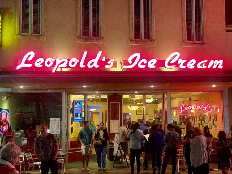 neon light sign and crowd at Leopold's Ice Cream