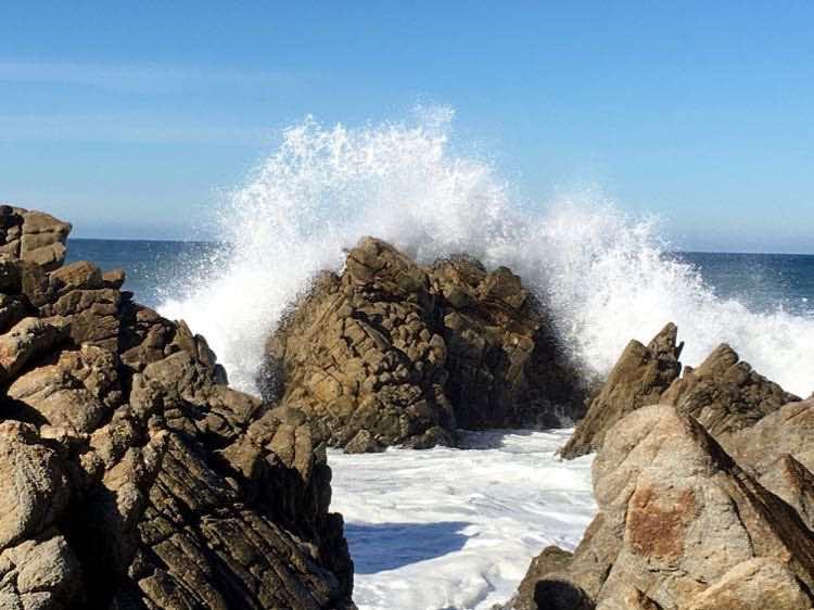 ocean waves hitting rocks in Pacific Grove Monterey