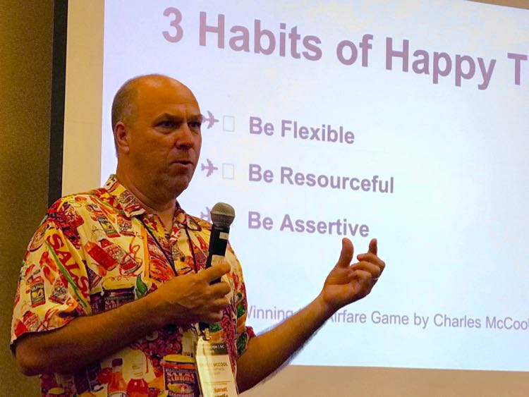 Charles McCool speaking about happy travel