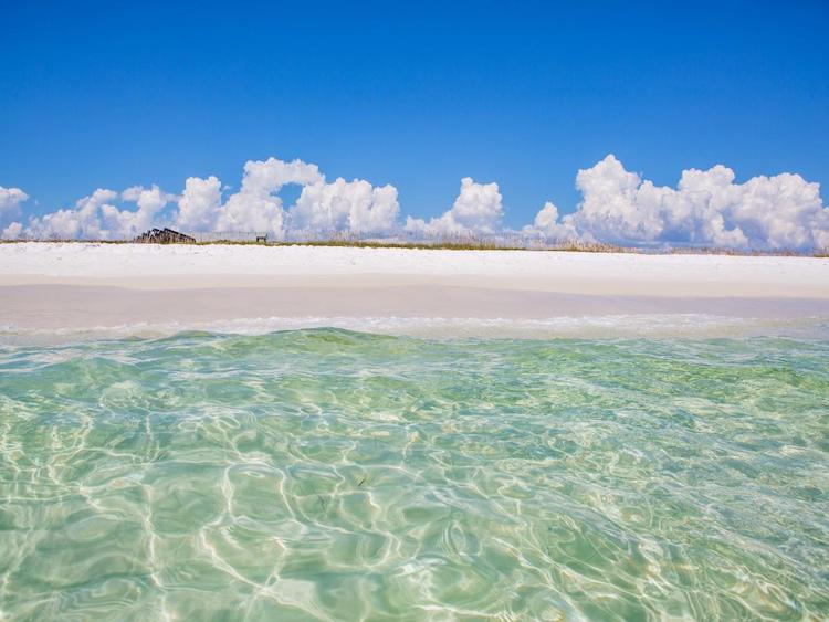 empty beaches with emerald water are coveted Florida hidden gems