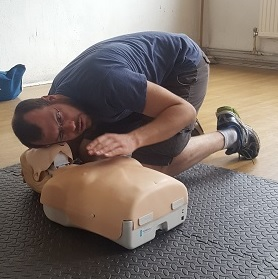 Checking to see if a casualty is breathing