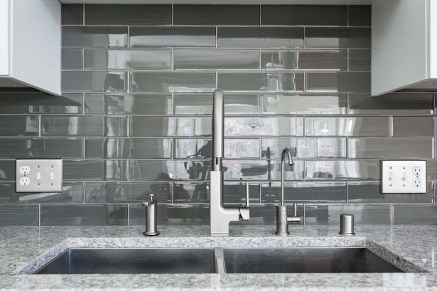 Blanco stainless steel sink with Moen STo Spot Resist Stainless One-Handle High Arc Pulldown Kitchen Faucet with glass tile backsplash