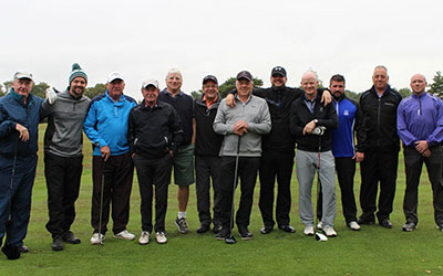 The McDonough Board playing golf