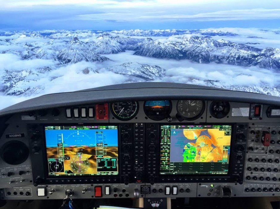 Garmin G1000 flying over mountains and clouds