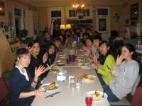 Members of the Newman community enjoying one of the Society's Saturday night suppers (photo courtesy of Holly Garnett)