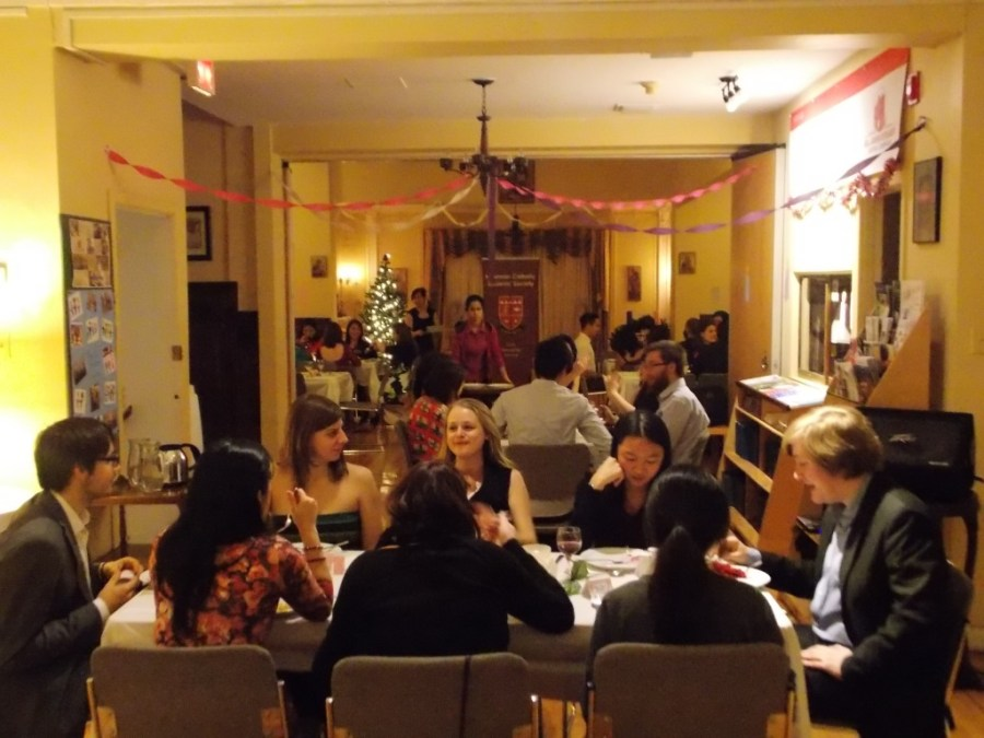 Members of the Newman community enjoy a tasty Christ is Coming Dinner in 2014 (photo credit unknown)