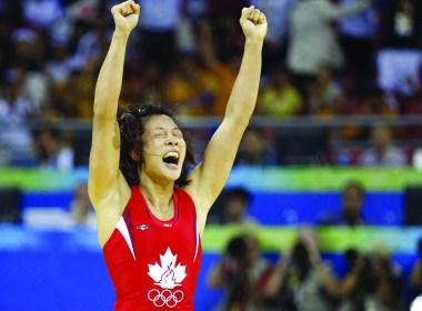 Carol Huynh celebrates a gold medal. (vancouverobserver.com)