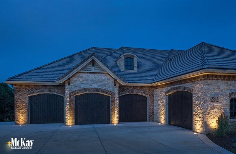 contemporary tudor home outdoor lighting