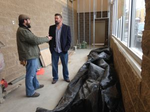 scott baker and project manager Wade Grann stand in the future corner market