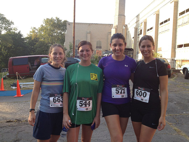 tricia levander poses with other runners at the Run Your Rox Off 5k.