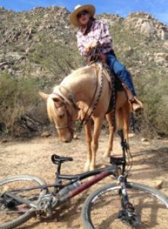 Horse and rider meet bike left in middle of trail