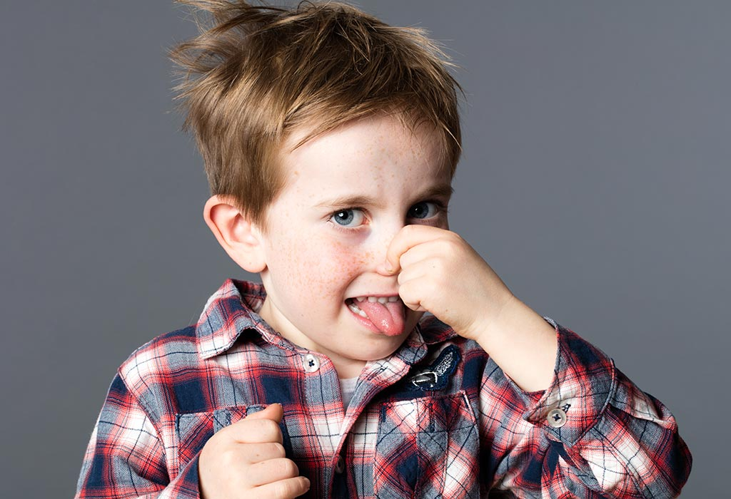 Photo of a boy making a stinky face. Fireplace service in the Spring reduces odors when the fireplace is not in use.