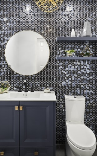 Indigo Vanity, champagne gold hardware, circular mirror, Kohler toilet, floating shelves and stunning feature Tile