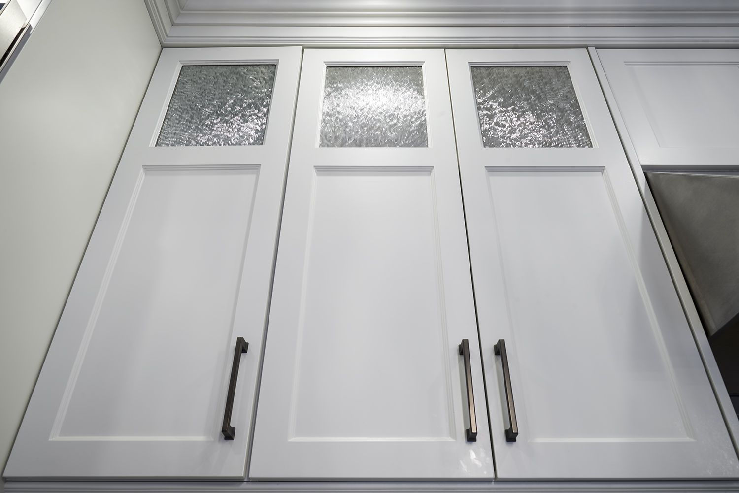 Tall Soaring Upper Cabinetry with Glass inserts