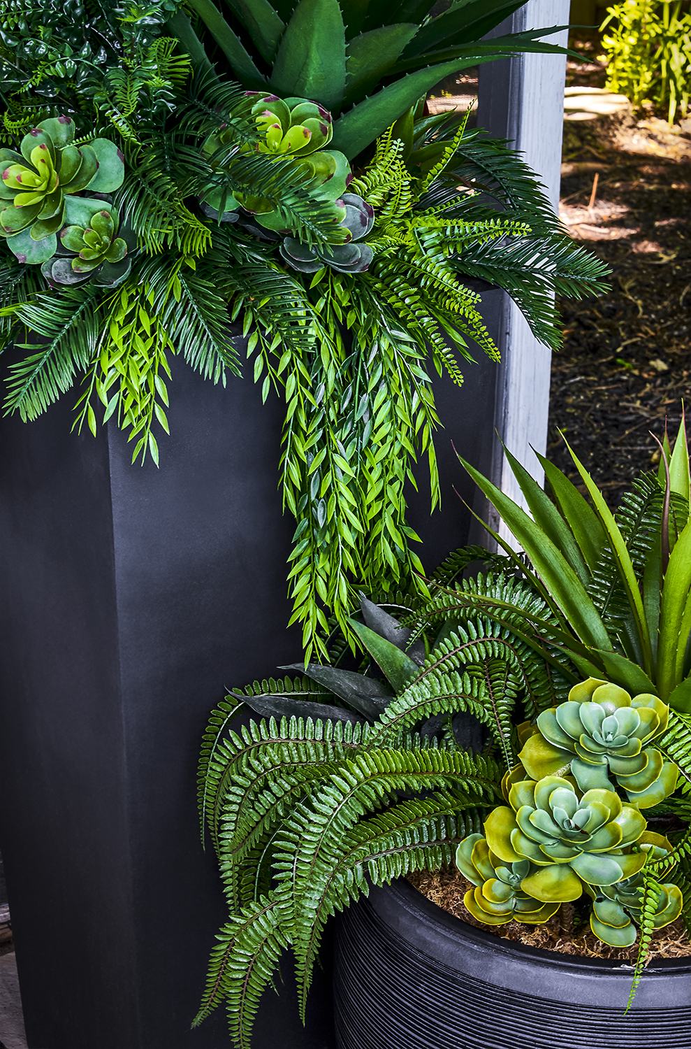 Everlasting exterior greenery and weather proof urns robustly created for the Client's Backyard Oasis