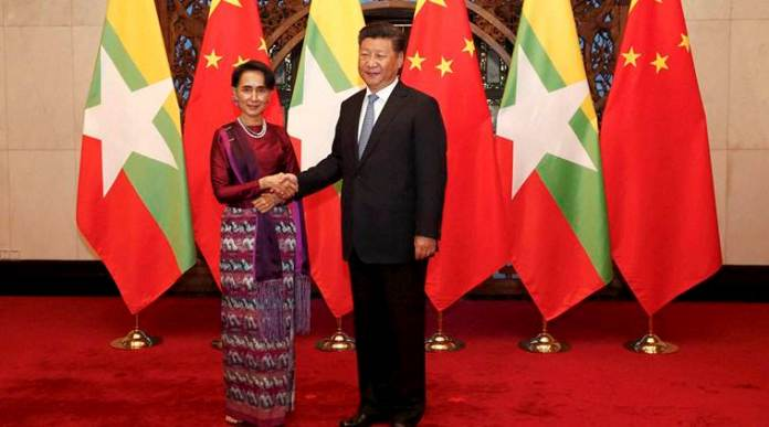 Beijing : Myanmar's State Counselor Aung San Suu Kyi, left, and Chinese President Xi Jinping, right, pose for the media before their meeting at the Diaoyutai State Guesthouse in Beijing, China, Friday, Aug. 19, 2016. Suu Kyi was welcomed by Premier Li Keqiang at a formal ceremony Thursday at part of a visit that will include talks with President Xi. The trip ending Sunday is her first to China since her party won a historic majority last year. AP/PTI(AP8_19_2016_000169B)