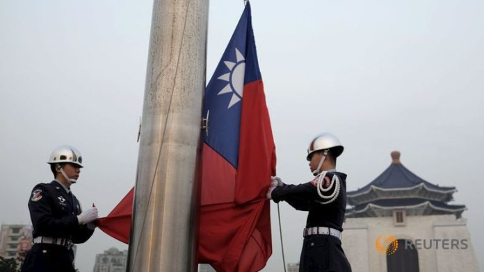military-honor-guards-lower-the-taiwanese-flag-at-liberty-square