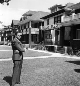 Motown founder Berry Gordy, Jr. in front of 'Hitsville' in 1962 (Click image for larger view)