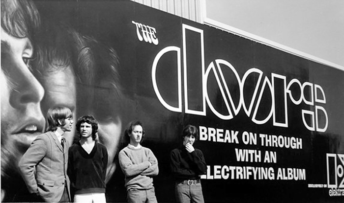 THE DOORS photographed in Los Angeles posing in front of a billboard promoting their debut album 1967. (Click image for larger view)  sc 1 st  Motor City Radio Flashbacks & THE DOORS EMERGES \u0027HOT\u0027 WEST COAST BAND . . . JUNE 10 1967 \u2013