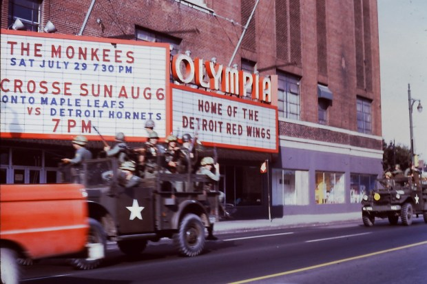National Guardsmen patrolling Detroit's Grand River Avenue in front of the Olympia, Thursday, July 27, 1967
