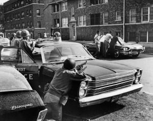 Policemen arrest suspects in a Detroit street on July 25, 1967 during riots that erupted in Detroit following a police operation. (Photo credit: Getty Images)