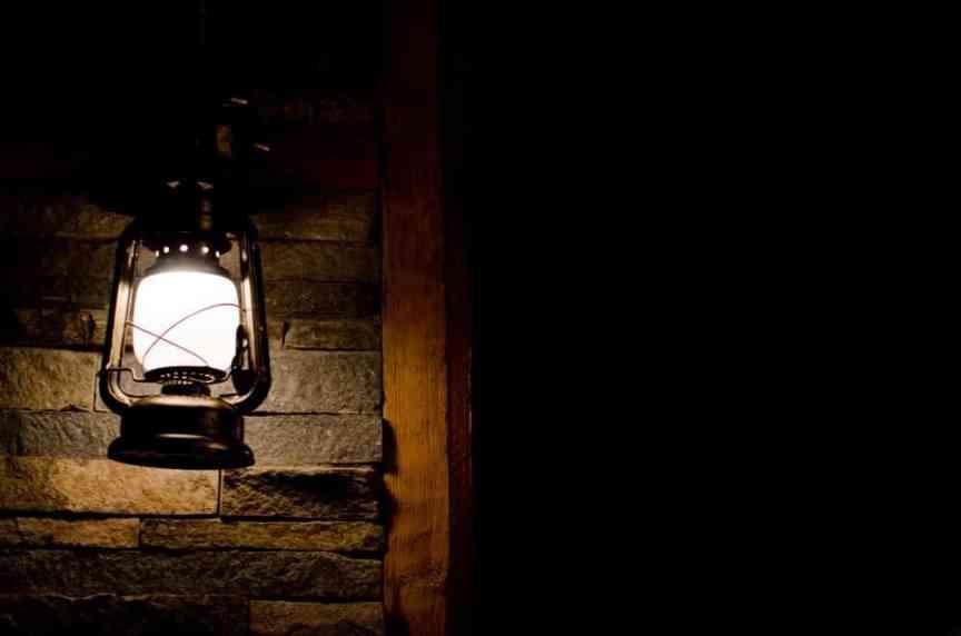 Shining lantern in complete darkness