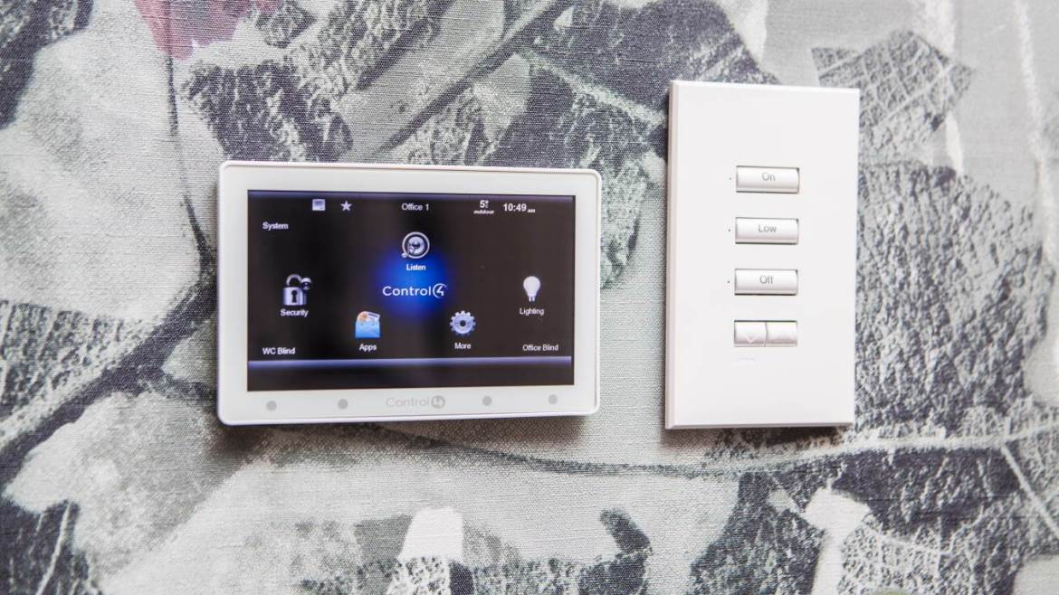 Control4 smart home control device installed to wall in London home